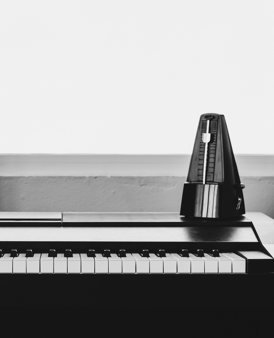 Piano with metronome. Music instrument. Art and abstract background in black and white theme with copy space.